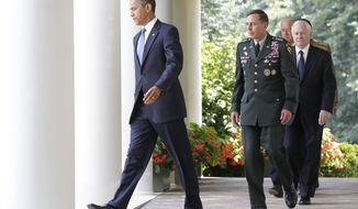 ** FILE ** President Obama, followed by, from second from left, Gen. David Petraeus, Defense Secretary Robert Gates, Vice President Joseph R. Biden Jr., and Joint Chiefs Chairman Adm. Michael Mullen, walks to the Rose Garden of the White House in Washington, Wednesday, June 23, 2010. (AP Photo/Charles Dharapak)