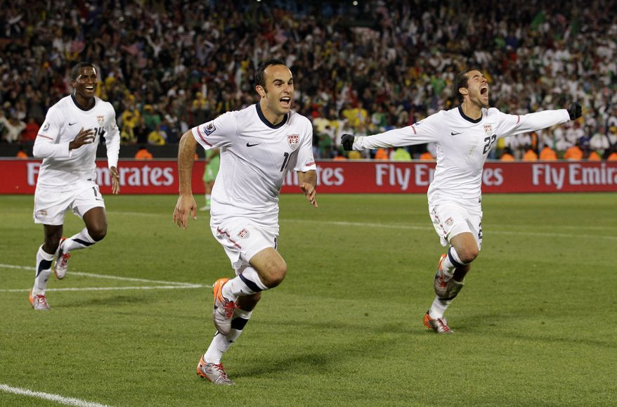 United States' Landon Donovan, center, celebrates after scoring a goal with fellow team members Benny Feilhaber, right, and Edson Buddle, left, during the World Cup Group C soccer match between the United States and Algeria at the Loftus Versfeld Stadium in Pretoria, South Africa, Wednesday, June 23, 2010. (AP Photo/Elise Amendola)