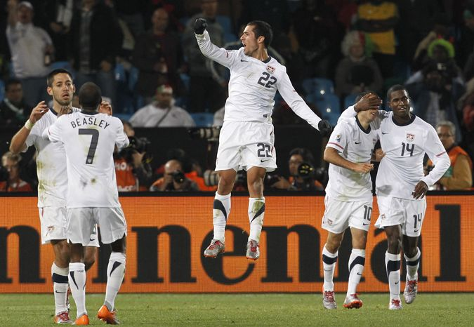 United States' Landon Donovan, second from right, celebrates with teammates after scoring during the World Cup group C soccer match between the United States and Algeria at the Loftus Versfeld Stadium in Pretoria, South Africa, Wednesday, June 23, 2010. (AP Photo/Bernat Armangue)