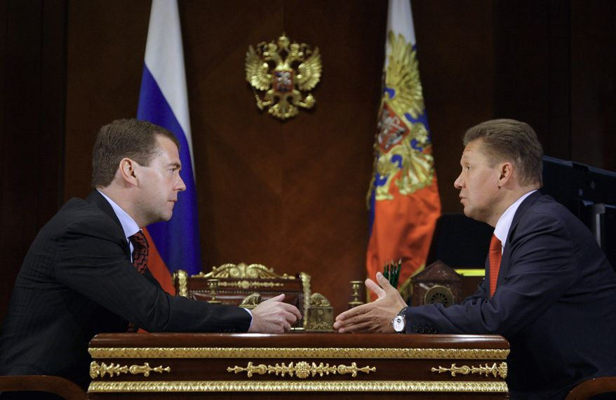 Russian President Dmitry Medvedev, left, and Russian gas monopoly Gazprom head, Alexei Miller, meet at the Gorki presidential residence outside Moscow, Monday, June 21, 2010. Mr. Medvedev ordered the state-controlled gas monopoly Monday to cut gas supplies to ex-Soviet neighbor Belarus over its debt for Russian natural gas supplies. On Thursday, June 24, 2010, Russia announced it will resume supply to Belarus. (AP Photo/RIA Novosti, Dmitry Astakhov, Presidential Press service)