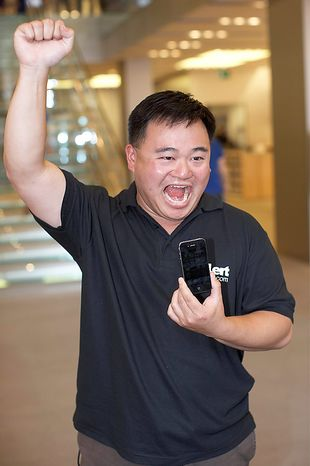 Customer Alex Lee celebrates receiving his new Apple Inc. iPhone 4,having been the first in the line, in London, on Thursday, June 24, 2010. Apple Inc. will probably sell a record 1 million iPhones today when the new version debuts and people such as John Whalen line up outside stores to be the first to buy it. Photographer Rupert Hartley/Bloomberg