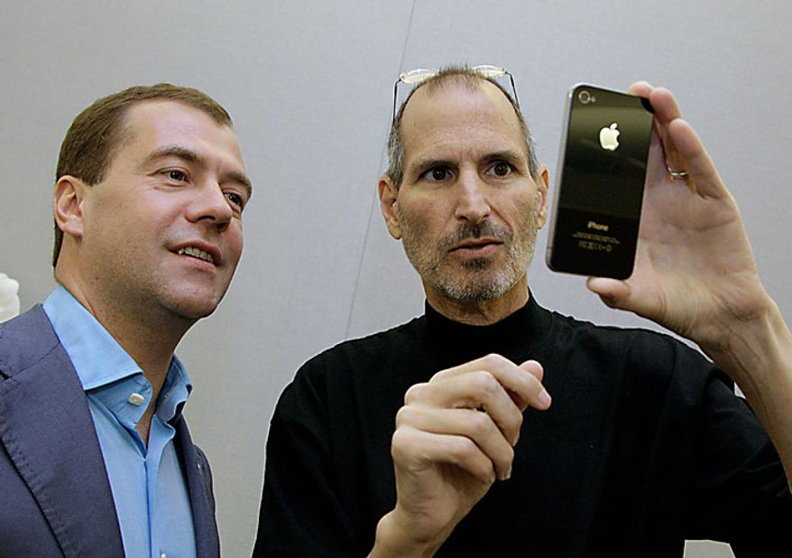 In this Wednesday, June 23, 2010, photo Russian President Dmitry Medvedev looks at an iPhone 4 with Apple Chairman and CEO Steve Jobs at Apple Inc. in Cupertino, Calif. Mr. Medvedev visited Silicon Valley as part of a U.S. tour that took him to Washington for meetings with President Obama on Thursday. (AP Photo/RIA-Novosti, Dmtiry Astakhov, Presidential Press Service)