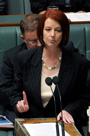 Australia's new Prime Minister Julia Gillard speaks during a House of Representatives question time at Parliament House in Canberra, Australia on Thursday, June 24, 2010.  Australia has its first female prime minister after the ruling party ousted Prime Minister Kevin Rudd and installed his deputy, Ms. Gillard, as leader.  (AP Photo/AAP Image, Alan Porritt)