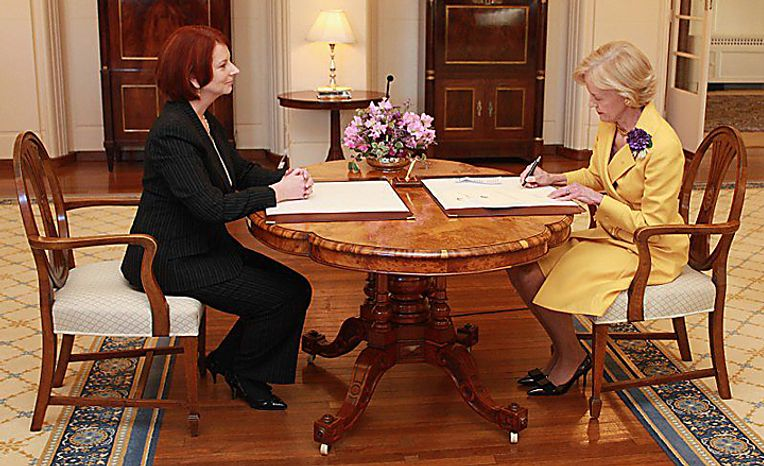 Julia Gillard of the Labor Party, left, is sworn in as Australia's new prime minister by Governor-General Quentin Bryce, at Government House in Canberra, Australia, on Thursday, June 24, 2010. Gillard became Australia's first female prime minister, ousting Kevin Rudd as Labor Party leader after his plans to boost taxes on the mining industry deepened a slump in opinion polls. Source: Australia's Government House via Bloomberg