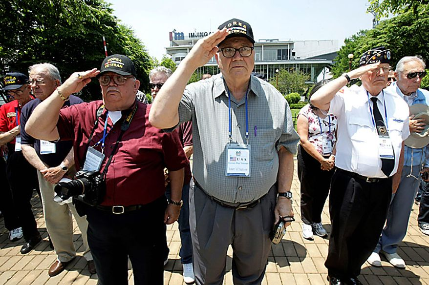 U.S. veterans who fought in the Korean War salute during a ceremony to mark the 60th anniversary of the Korean War at the Imjingak Pavilion in Paju near the border village of Panmunjom, the demilitarized zone that separates the two Koreas since the Korean War, north of Seoul, South Korea, on Thursday, June 24, 2010. The United States and 15 other countries fought alongside South Korea under the U.N. flag against North Korean and Chinese troops. (AP Photo/Ahn Young-joon)