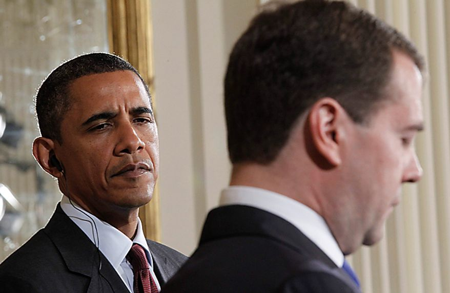 President Barack Obama and Russian President Dmitry Medvedev take part in a joint news conference in the East Room of the White House in Washington, Thursday, June 24, 2010. (AP Photo/Pablo Martinez Monsivais)