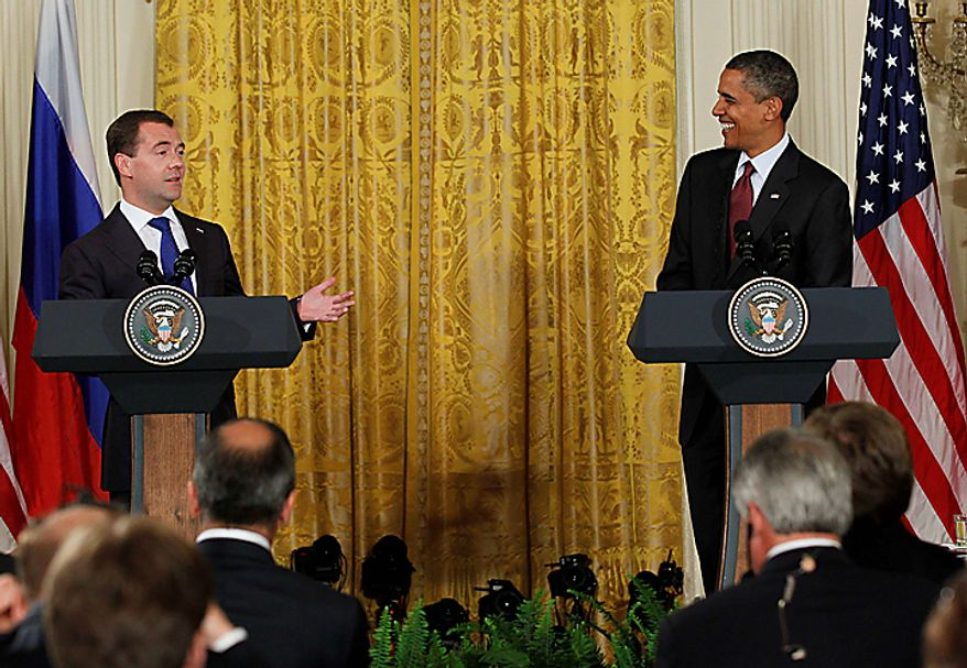 President Barack Obama and Russia's President Dmitry Medvedev take part in a joint news conference in the East Room of the White House in Washington, Thursday, June 24, 2010. (AP Photo/J. Scott Applewhite)