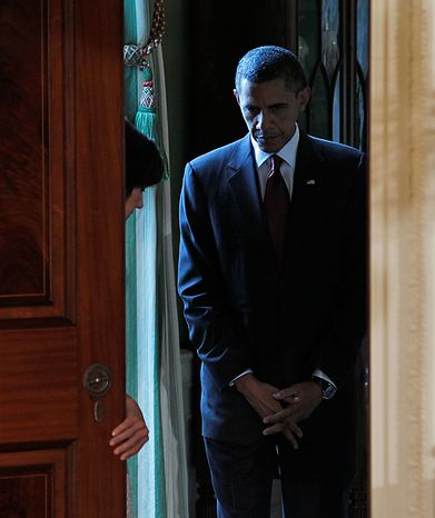 President Barack Obama waits to be announced before a joint news conference with Russia's President Dmitry Medvedev, Thursday, June 24, 2010,  in the East Room of the White House in Washington. (AP Photo/Pablo Martinez Monsivais)