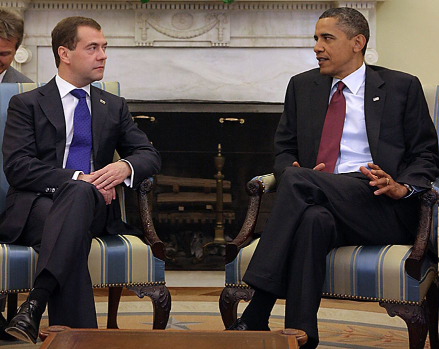 President Barack Obama and Russia's President Dmitry Medvedev, left, seen during talks in the White House in Washington, Thursday, June 24, 2010. (AP Photo/RAI-Novosti, Mikhail Klimenthev, Presidential Press Service)