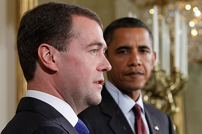 *FILE PHOTO.* President Barack Obama and Russia's President Dmitry Medvedev take part in a joint news conference in the East Room of the White House in Washington, Thursday, June 24, 2010. (AP Photo/Pablo Martinez Monsivais)