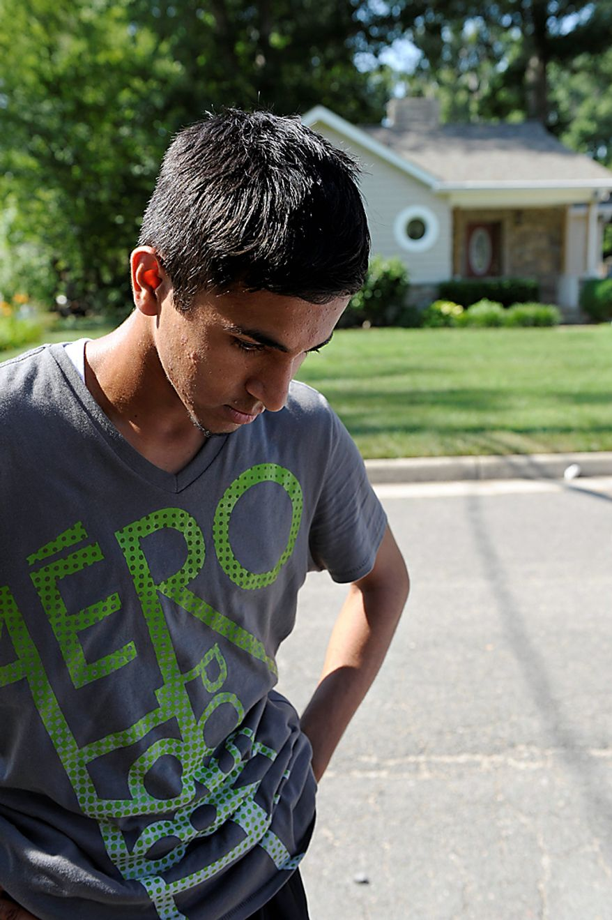 Junaid Maqsood, 15, of Alexandria, Va, stands on the street where two of the five American's who were convicted by a Pakistani court, lived in Alexandria, Thursday, June 24, 2010.  The five American men were convicted Thursday on terror charges by a Pakistan court and sentenced to 15 years in prison each, a prosecutor said. The judge handed down two prison terms for each man, one for 10 years and the other for five, said deputy prosecutor Rana Bakhtiar.  (AP Photo/Cliff Owen)