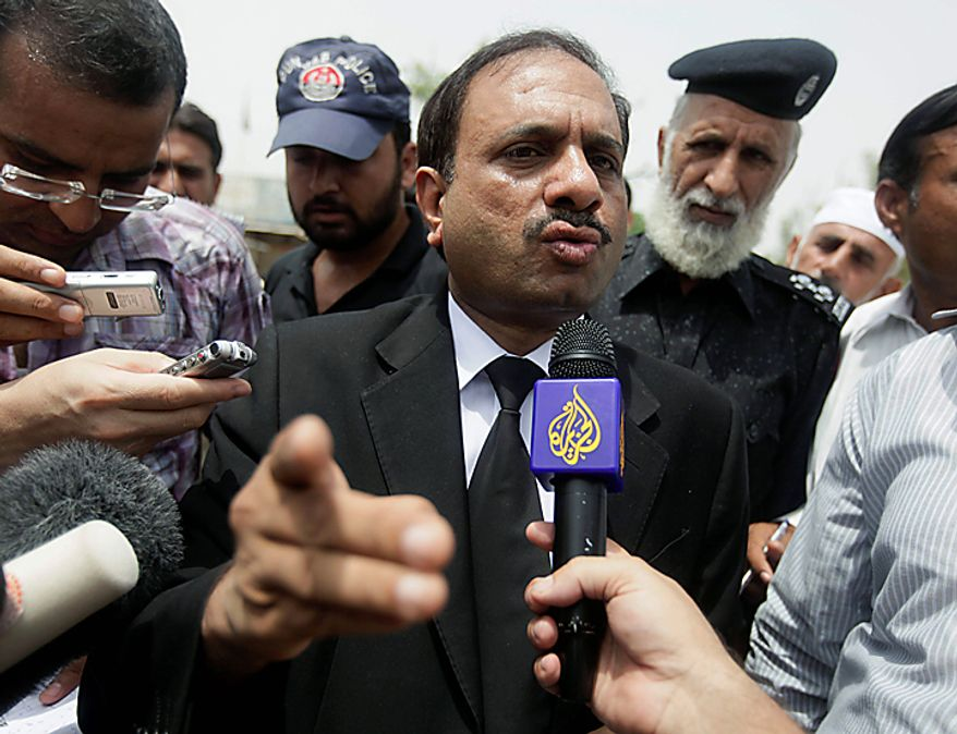 Deputy prosecutor Rana Bakhtiar  is mobbed by the press outside the district jail where five young Muslims from the Washington, D.C. area who were arrested in Pakistan in December are being held, in Sargodha, Pakistan, Thursday, June 24, 2010. The five American men were convicted Thursday on terror charges by a Pakistan court and sentenced to 15 years in prison each, the prosecutor said. The judge handed down two prison terms for each man, one for 10 years and the other for five, said Bakhtiar. (AP Photo/Dita Alangkara)