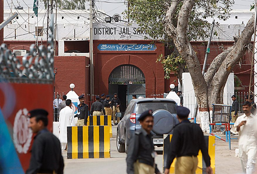 Pakistani police officers stand guard outside the district jail, where five young American Muslims from the Washington, D.C. area who were arrested in Pakistan in December, are being held in Sargodha, Pakistan, Thursday, June 24, 2010. The five American men were convicted Thursday on terror charges by a Pakistan court and sentenced to 15 years in prison each, a prosecutor said. The judge handed down two prison terms for each man, one for 10 years and the other for five, said deputy prosecutor Rana Bakhtiar. (AP Photo/Dita Alangkara)