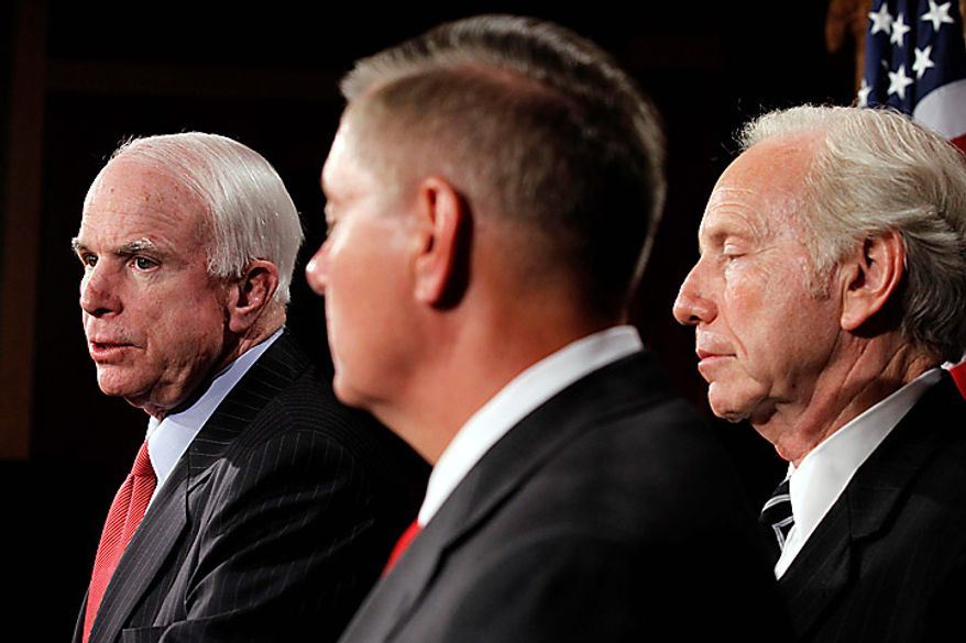 Senate Armed Services Committee members, from left, Sen. John McCain, R-Ariz., the committee's ranking Republican, Sen. Lindsey Graham, R-S.C., and Sen. Joseph Lieberman, I-Conn., take part in a news conference on Capitol Hill in Washington, Wednesday, June 23, 2010, to talk about confirmation hearings for Gen. David Petraeus. (AP Photo/Alex Brandon)