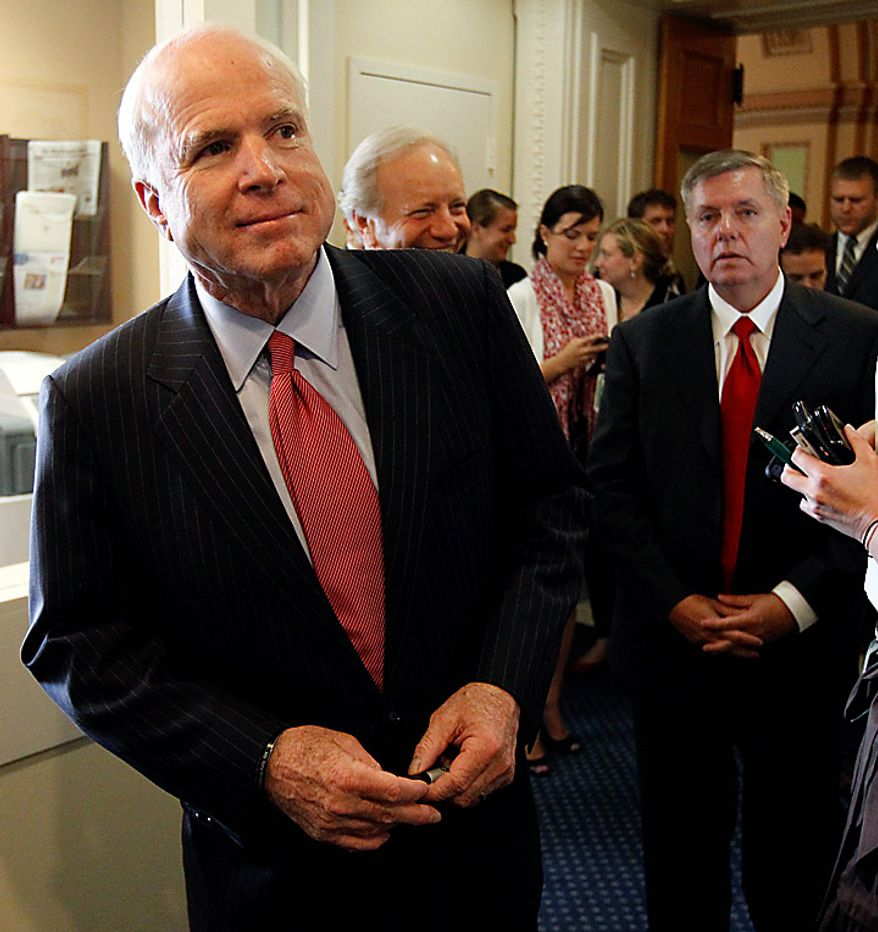 The Senate Armed Services Committee's ranking Republican, Sen. John McCain, left, R-Ariz., left, accompanied by fellow committee members, Sen. Joseph Lieberman, I-Conn., and Sen. Lindsey Graham, R-S.C., walk to a news conference on Capitol Hill in Washington, Wednesday, June 23, 2010, to discuss  the confirmation hearings for Gen. David Petraeus. (AP Photo/Alex Brandon)