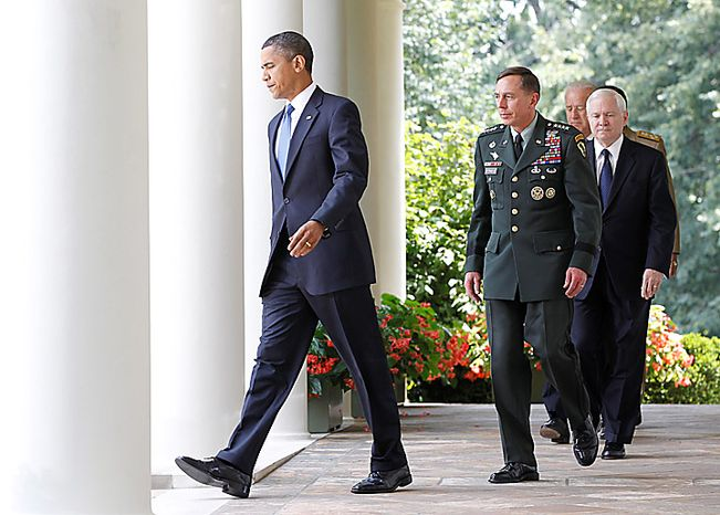 President Barack Obama, followed by, from second from left,  Gen. David Petraeus, Defense Secretary Robert Gates, Vice President Joe Biden, and Joint Chiefs Chairman Adm. Michael Mullen, walks to the Rose Garden of the White House in Washington, Wednesday, June 23, 2010, to announce that Petraeus would replace Gen. Stanley McChrystal. (AP Photo/Charles Dharapak)