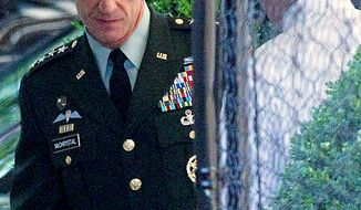 Gen. Stanley McChrystal arrives at the White House in Washington, Wednesday, June 23, 2010, for a meeting with President Barack Obama. (AP Photo/Evan Vucci)
