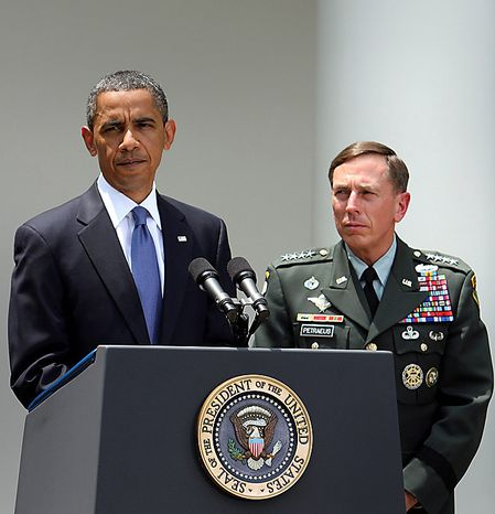 U.S. President Barack Obama makes remarks on the resignation of Army General Stanley McChrystal, the commander of U.S. troops in Afghanistan, while Army General David Petraeus listens at right, in the Rose Garden of the White House in Washington, D.C., U.S., on Wednesday, June 23, 2010. Obama said McChrystal will be replaced by Petraeus, commander of U.S. forces in the Middle East and Central Asia and the architect of the counterinsurgency strategy the U.S. is pursuing in Afghanistan. Photographer: Chris Kleponis/Bloomberg