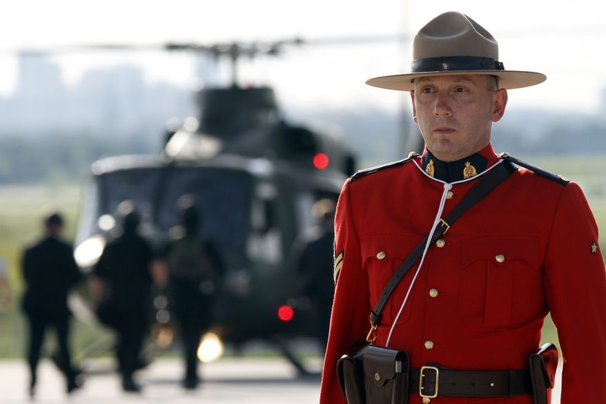 A Royal Canadian mounted police officer stands guard as Britain's Prime Minister David Cameron, not seen, and his delegation arrives in Toronto, Canada, Thursday, June 24, 2010, to attend the G8 and the G20 meetings. (AP Photo/Lefteris Pitarakis)