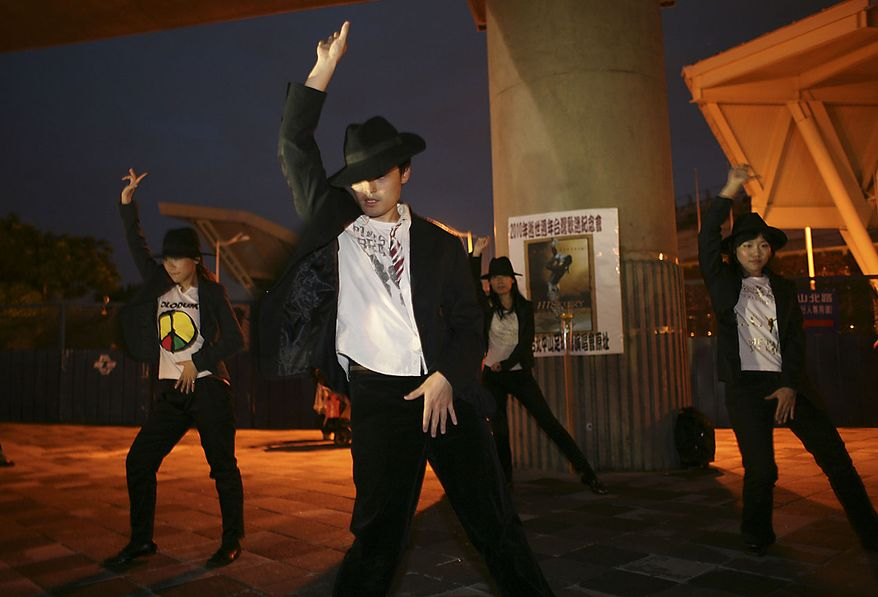 Dancers impersonate Michael Jackson during a gathering ahead of the first anniversary of his death June 25, 2010 in Taipei, Taiwan. (AP Photo/Wally Santana)