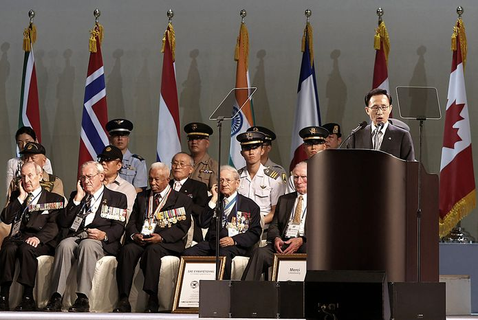 South Korean President Lee Myung-bak speaks during a ceremony to mark the 60th anniversary of the outbreak of the Korean War in Seoul, South Korea, Friday, June 25, 2010. The two Koreas commemorated the anniversary Friday of the war, promoting vastly different views of the origins of the conflict that still divides their peninsula a full six decades later. (AP Photo/Ahn Young-joon)