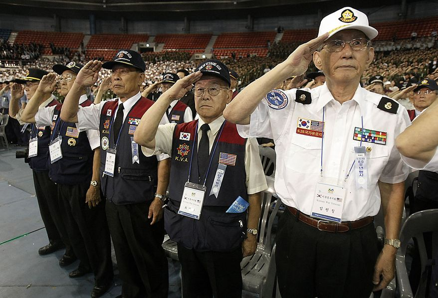 Korean War veterans salute during a ceremony to mark the 60th anniversary of the outbreak of the Korean War in Seoul, South Korea, Friday, June 25, 2010. The two Koreas commemorated the anniversary Friday of the war, promoting vastly different views of the origins of the conflict that still divides their peninsula a full six decades later.(AP Photo/Ahn Young-joon)