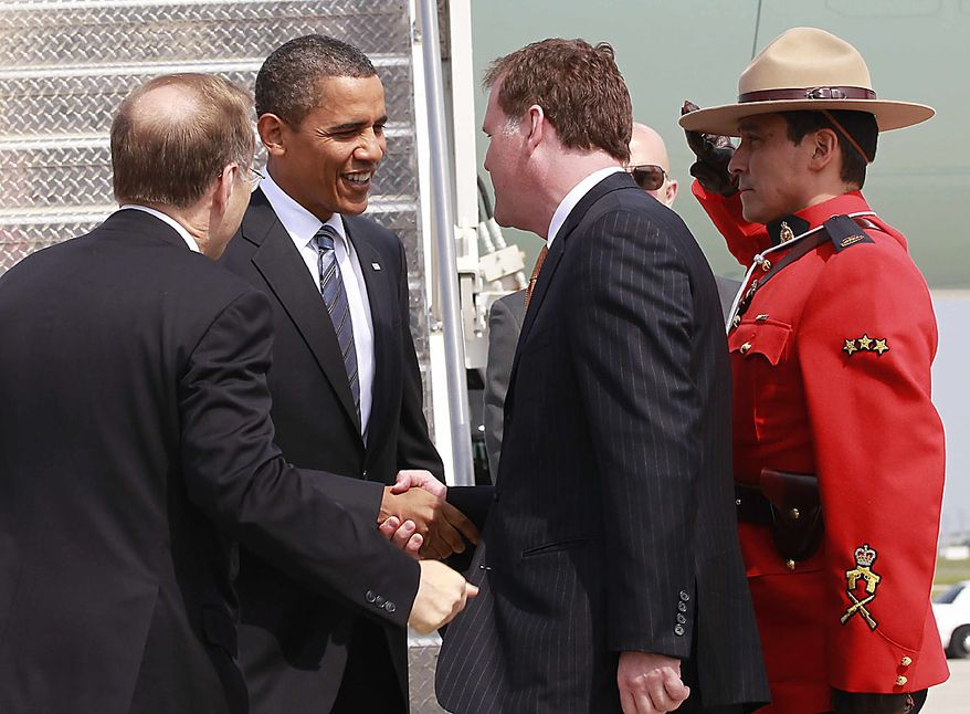 President Obama is greeted upon his arrival in Toronto, Friday, June 25, 2010, for the G-20 summit. (AP Photo/Charles Dharapak)