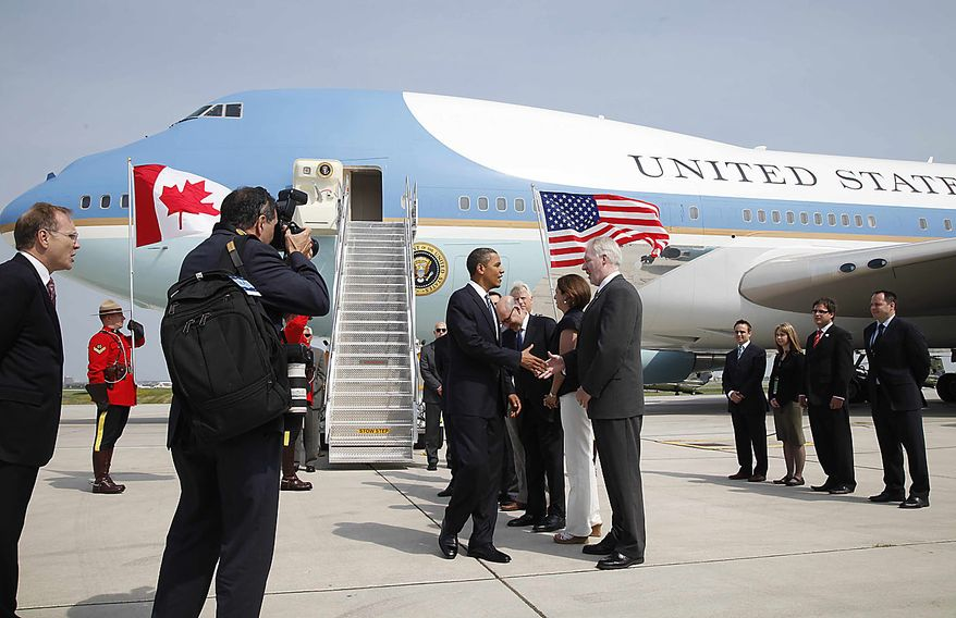 President Obama greets unidentified officials upon his arrival in Toronto, Friday, June 25, 2010, for the G-20 summit. (AP Photo/Charles Dharapak)