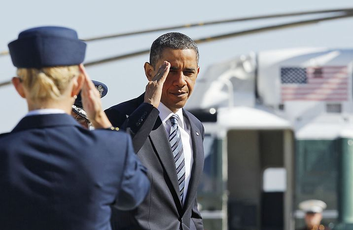 President Obama returns a salute prior to boarding Air Force One at Andrews Air Force Base, Md., Friday, June 25, 2010, prior to traveling to Canada for the G-20 summit. (AP Photo/Charles Dharapak)