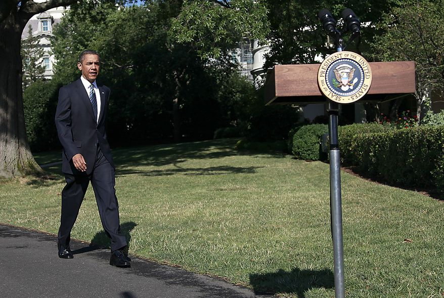President Obama walks toward the podium on the South Lawn of the White House in Washington, Friday, June 25, 2010, to speak to members of the media before traveling to attend the G-20 summit in Canada. (AP Photo/Pablo Martinez Monsivais)