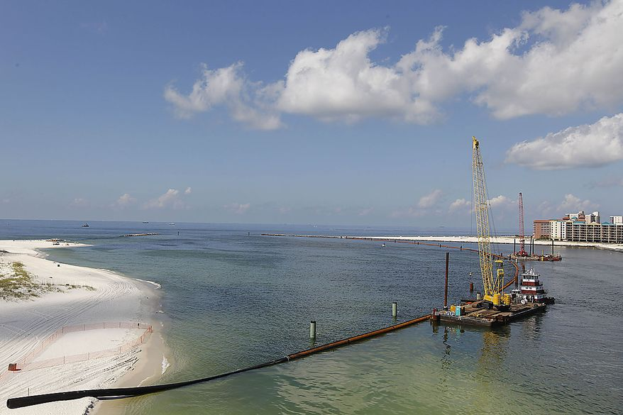 Booming operations continue across the Perdido Pass in Orange Beach, Ala., Friday, June 25, 2010. Oil from the Deepwater Horizon disaster continues to wash ashore along the Alabama and Florida coasts. (AP Photo/Dave Martin)