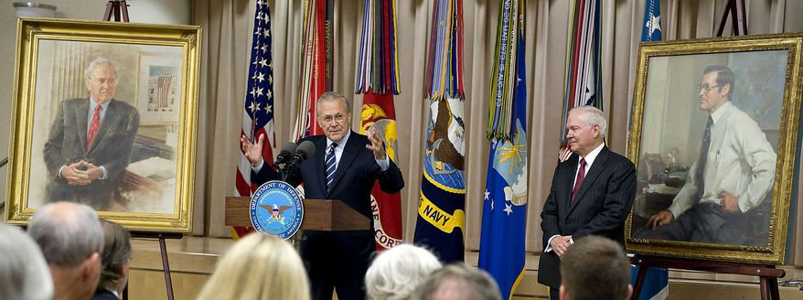 In this photo provided by the Department of Defense, former Defense Secretary Donald H. Rumsfeld talks to members of the audience with Defense Secretary Robert M. Gates, right, at his side and flanked by both of Rumsfeld portraits during the unveiling ceremony of the second one at the Pentagon, in Arlington, Va. Friday June 25, 2010. Mr. Rumsfeld served as secretary of defense under President Gerald Ford from 1975 to 1977 and under President George W. Bush from 2001 to 2006. (AP Photo/DOD, Cherie Cullen)