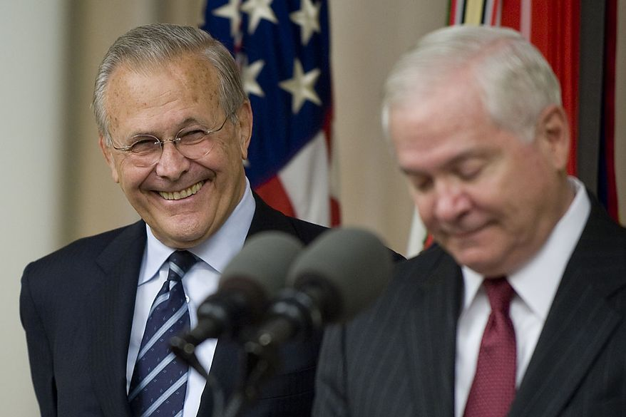 In this photo provided by the Department of Defense, former Defense Secretary Donald H. Rumsfeld smiles as Defense Secretary Robert M. Gates, right, addresses the audience  during Mr. Rumsfeld's portrait unveiling ceremony at the Pentagon, in Arlington, Va. Friday June 25, 2010.  (AP Photo/DOD, Cherie Cullen)
