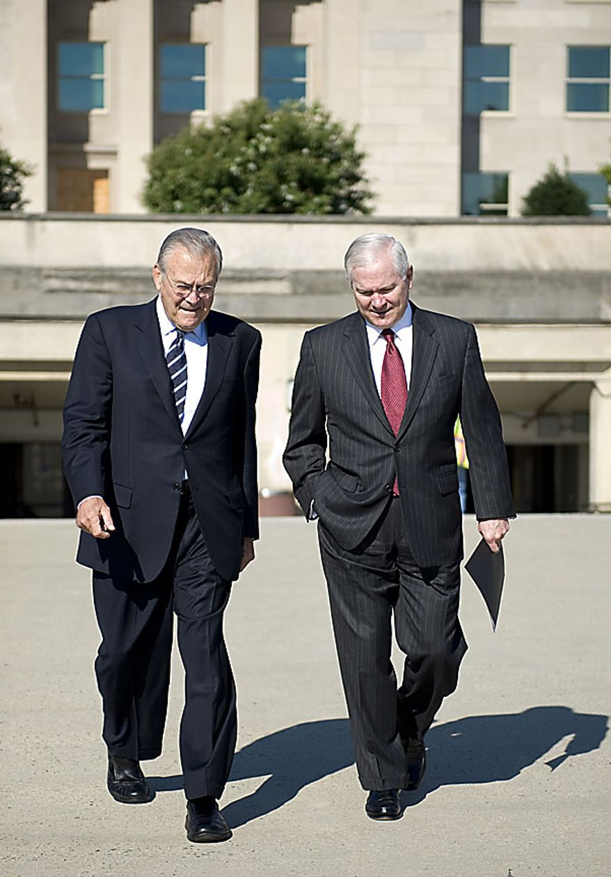 In this photo provided by the Department of Defense, Defense Secretary Robert M. Gates, right, and former Defense Secretary Donald H. Rumsfeld walk to Mr. Rumsfeld's portrait unveiling ceremony at the Pentagon, in Arlington, Va. Friday June 25, 2010.  (AP Photo/DOD, Cherie Cullen)