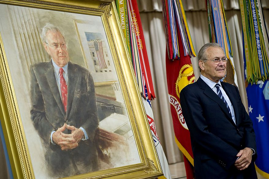 In this photo provided by the Department of Defense, former Defense Secretary Donald H. Rumsfeld stands next to his official portrait during the unveiling ceremony at the Pentagon, in Arlington, Va. Friday June 25, 2010.  (AP Photo/DOD, Cherie Cullen)