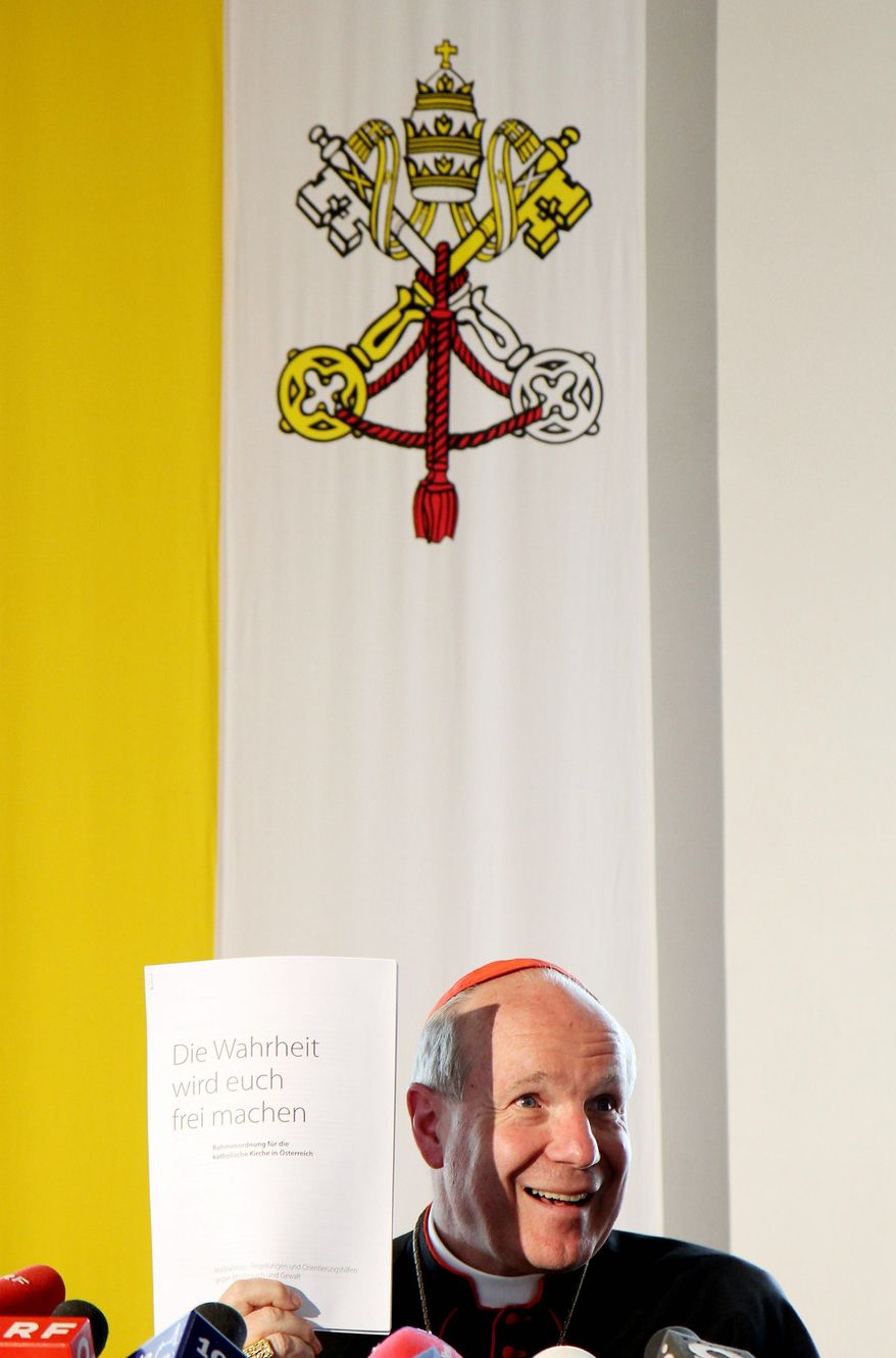 "Austrian Cardinal Christoph Schonborn presents a paper with the title ""The Truth Shall Make You Free"" during a news conference in Austria. The cardinal has developed a set of measures, to take effect July 1, intended to prevent abuse by clergy and help victims. He has apologized ""for everything that my predecessors and other holders of church office committed against people in their trust."" (Associated Press)"