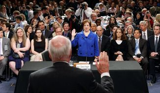 """ASSOCIATED PRESS Sen. Patrick J. Leahy swears in nominee Elena Kagan. """"The Supreme Court is a wondrous institution. But the time I spent in the other branches of government remind me that it must also be a modest one - properly deferential to the decisions of the American people and their elected representatives,"""" she said."""