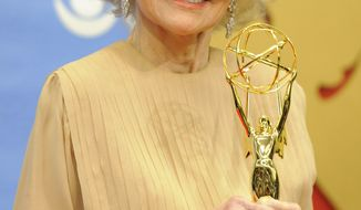 Veteran actress Agnes Nixon poses with her Lifetime Achievement Award backstage at the Annual Daytime Emmy Awards in Las Vegas, Sunday, June 27, 2010. (AP Photo/Chris Pizzello)