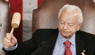 In this April 30, 2008 file photo, Senate President Pro Tem Sen. Robert Byrd., West Virginia Democrat, bangs the gavel on Capitol Hill in Washington, prior to outgoing Irish Prime Minister Bertie Ahern's address to a joint meeting of Congress. Mr. Byrd a fiery orator versed in the classics and a hard-charging power broker who steered billions of federal dollars to the state of his Depression-era upbringing, died Monday, June 28, 2010 (AP Photo/Susan Walsh, File)