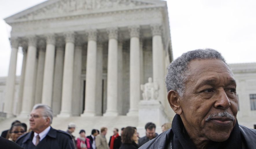 """In this file photo taken March 2, 2010 in Washington, Otis McDonald, one of four plaintiffs in the Chicago handgun ban takes part in a news conference in front of the Supreme Court. Mr. McDonald has said he joined a federal lawsuit to challenge Chicago's 28-year-old handgun ban because he wants a handgun at home to protect himself from gangs. The Supreme Court held Monday June 28, 2010 that the Constitution's Second Amendment restrains government's ability to significantly limit """"the right to keep and bear arms,"""" advancing a recent trend by the John Roberts-led bench to embrace gun rights. Monday's decision did not explicitly strike down the Chicago area laws, ordering a federal appeals court to reconsider its ruling. But it left little doubt that they would eventually fall. (AP Photo/Haraz N. Ghanbari)"""