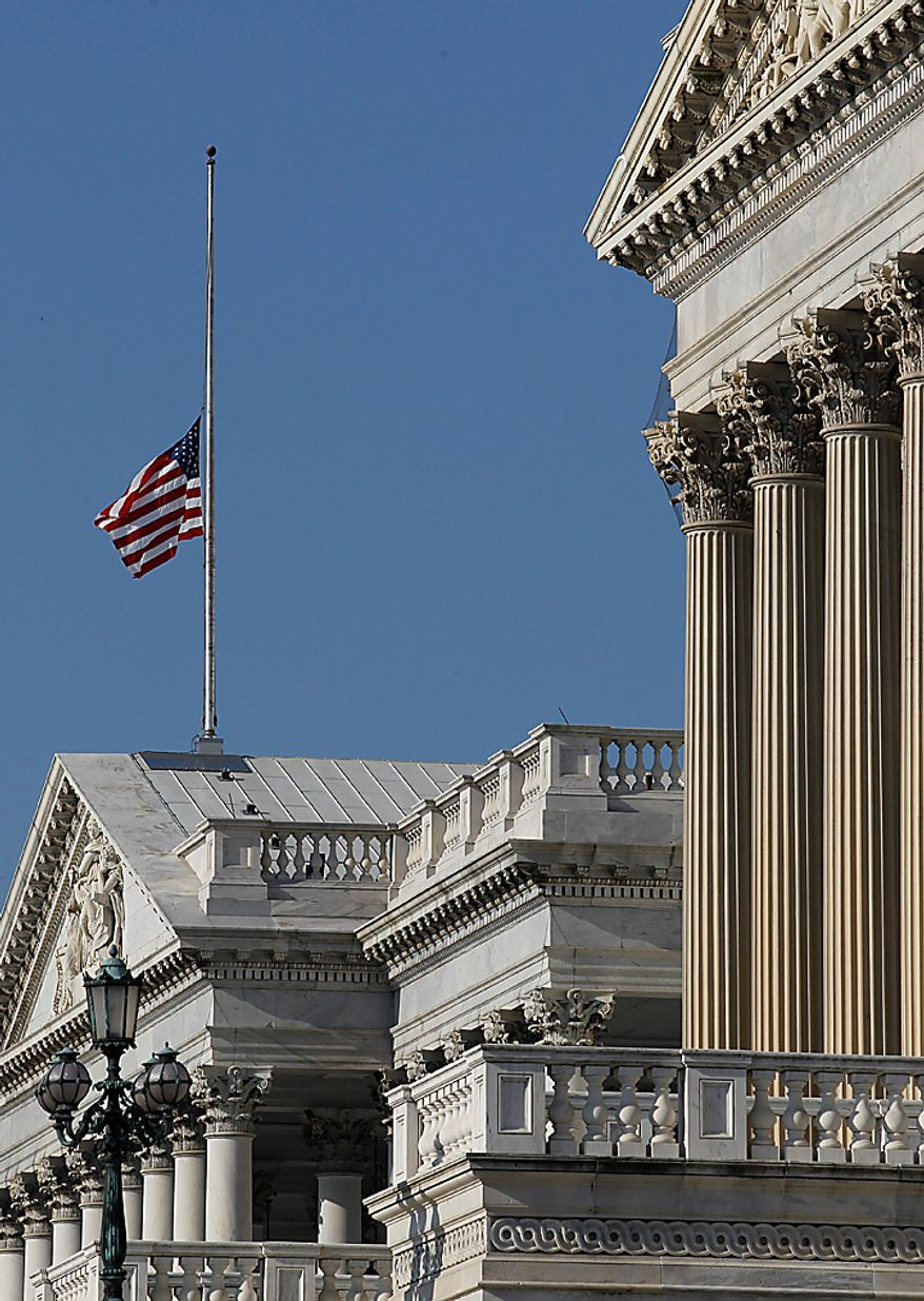 The flag over the U.S. Capitol flies at half staff in honor of the passing of West Virginia Democratic Sen. Robert C. Byrd in Washington Monday, June 28, 2010. Mr. Byrd, the longest serving member of the U.S. Senate, a fiery orator and hard-charging power broker who steered billions of federal dollars to his beloved West Virginia, died Monday. He was 92. (AP Photo/Alex Brandon)