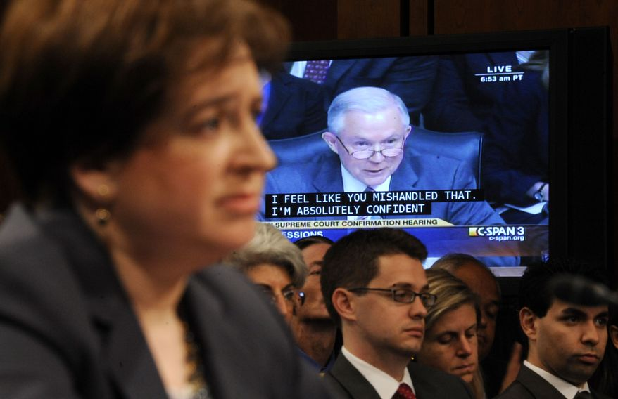 Supreme Court nominee Elena Kagan, foreground. listens to questions from Sen. Jeff Sessions, Alabama Republican, the ranking Republican on the Senate Judiciary Committee, on video screen, on Capitol Hill in Washington, Tuesday, June 29, 2010, during the committee's confirmation hearing for Kagan. (AP Photo/Susan Walsh)