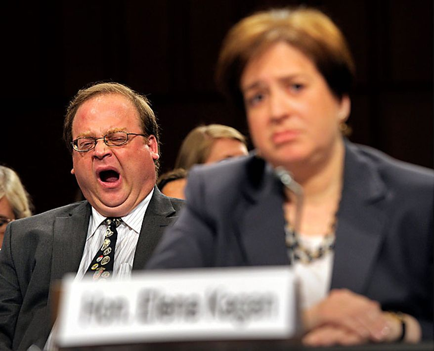 Supreme Court nominee Elena Kagan's brother Irving yawns on Capitol Hill in Washington, Tuesday, June 29, 2010, as Miss Kagan, right, testified before the Senate Judiciary Committee hearing on her nomination. (AP Photo/Susan Walsh)
