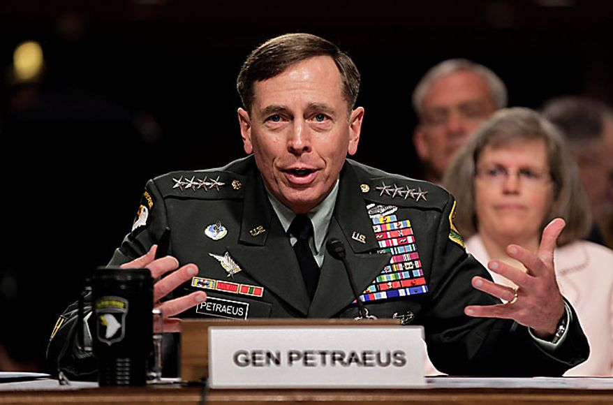 Gen. David Petraeus testifies on Capitol Hill in Washington, Tuesday, June 29, 2010, before the Senate Armed Services Committee hearing to be confirmed as President Obama's choice to take control of forces in Afghanistan. At right is his wife, Holly Petraeus.  (AP Photo/J. Scott Applewhite)