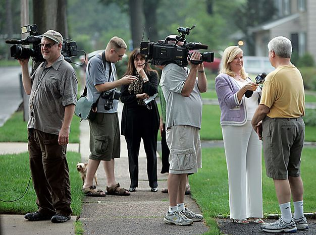 "Neighbors are interviewed on Marquette Road in Montclair, N.J., on Monday, July 28, 2010. Their neighbors, ""Richard Murphy"" and ""Cynthia Murphy"" were arrested by the FBI at their house on Sunday. (AP Photo/Rich Schultz)"