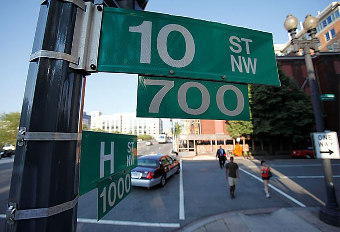 The intersection of 10th and H Street NW in Washington, Monday, June 28, 2010. According to court papers, an undercover FBI agent posing as a Russian agent met with Mikhail Semenko at this Washington location.  Ten people have been arrested for allegedly serving as secret agents of the Russian government with the goal of penetrating U.S. government policymaking circles. (AP Photo/Pablo Martinez Monsivais)