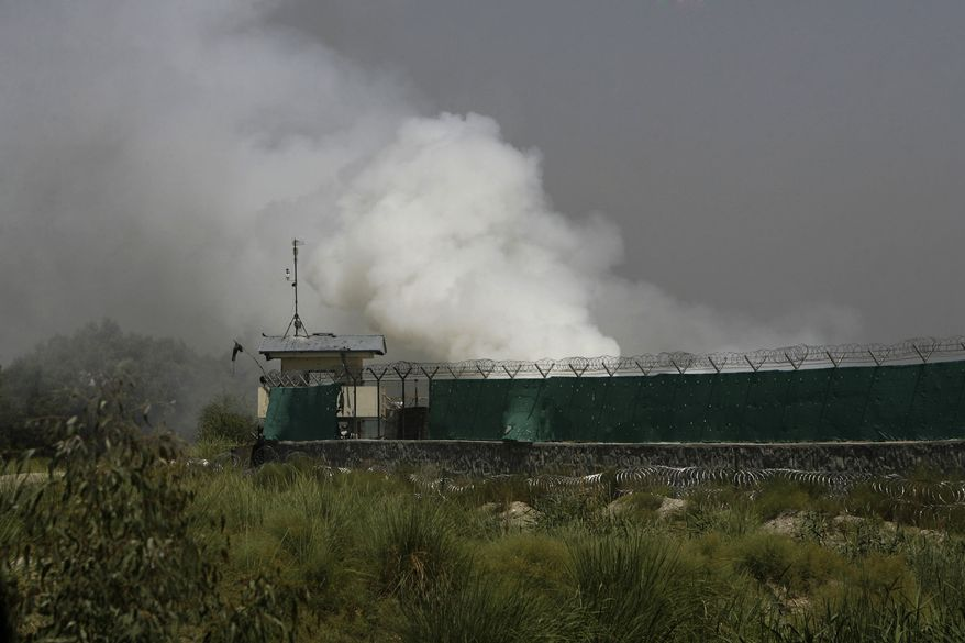 Smoke rises outside an airfield used by Afghan and international forces in Jalalabad, east of Kabul, Afghanistan, Wednesday, June 30, 2010. Militants set off a car bomb and stormed the entrance to the airport and eight insurgents died in the ensuing gunbattle, authorities said. (AP Photo)