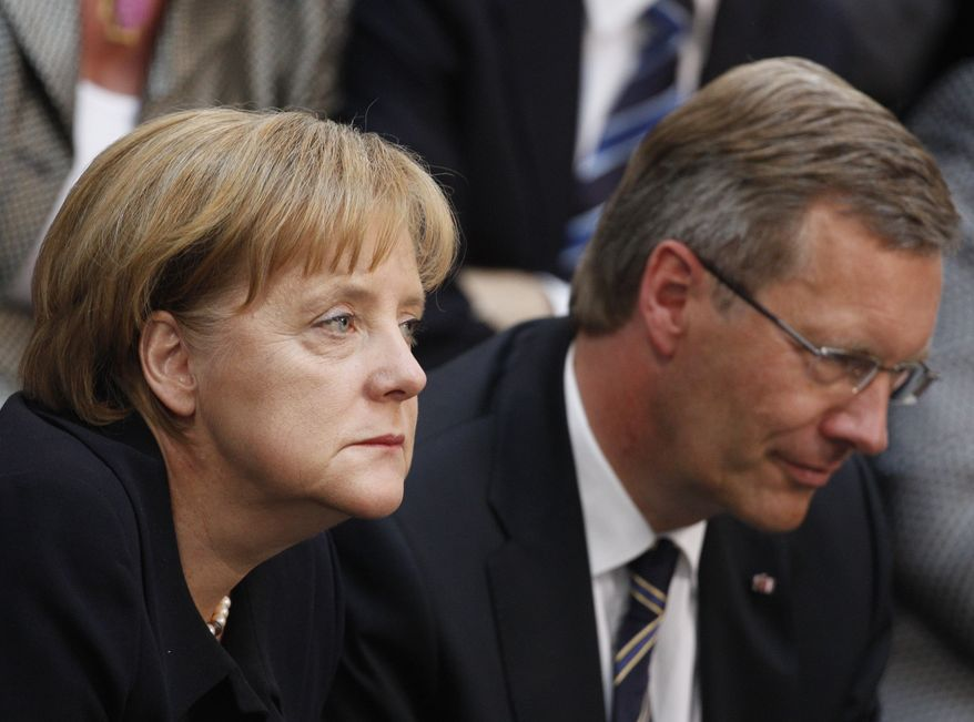 German Chancellor Angela Merkel and Christian Wulff, presidential candidate of the ruling German coalition, react prior to the election of the new German President during the Federal Assembly in the Berlin at the Reichstag parliament building, Wednesday, June 30, 2010. The Federal Assembly had to elect a new president after President Horst Koehler's resignation on May 31, 2010. (AP Photo/Markus Schreiber)