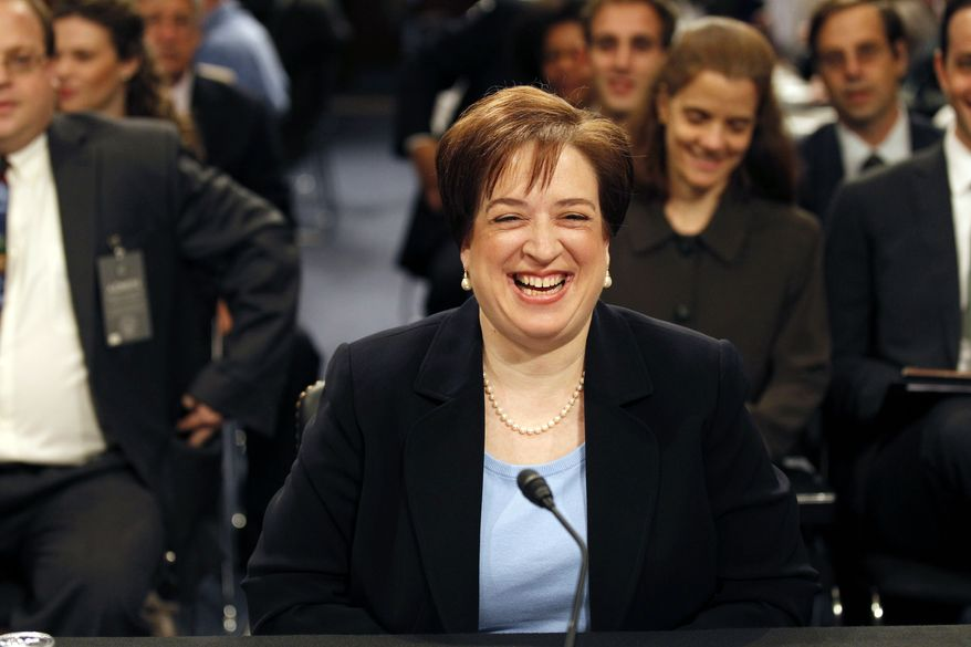 Supreme Court nominee Elena Kagan smiles as she takes her seat on Capitol Hill in Washington Wednesday, June 30, 2010, prior to the start of her continuing confirmation hearing before the Senate Judiciary Committee. (AP Photo/Alex Brandon)