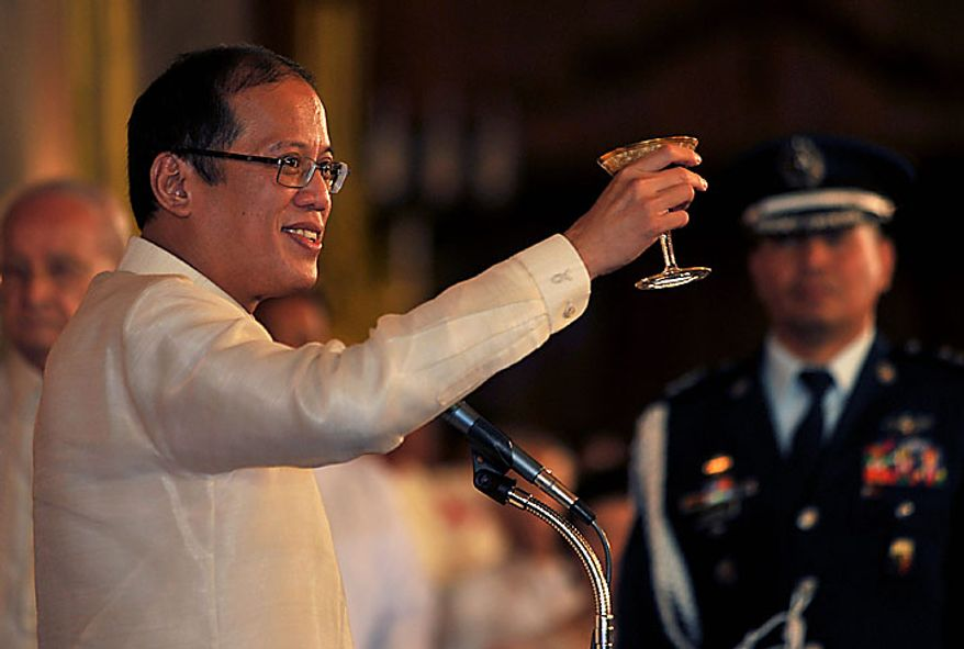 Philippine President Benigno Aquino III offers a toast during his inaugural reception at the Malacanang presidential palace in Manila, Philippines on Wednesday June 30, 2010. (AP Photo/Noel Celis, Pool)